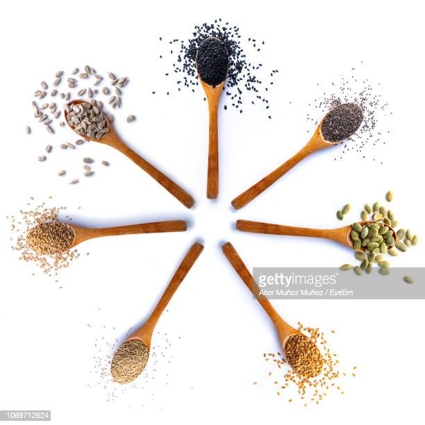 high angle view of various foods in spoons on white background - sesame stock pictures, royalty-free photos & images