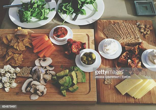 High Angle View Of Various Foods On Cutting Boards In Kitchen