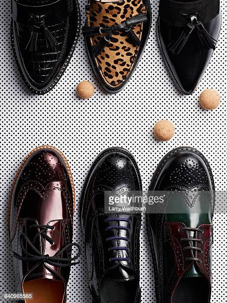 high angle view of various formal shoes on metal grate - レザー・シューズ ストックフォトと画像