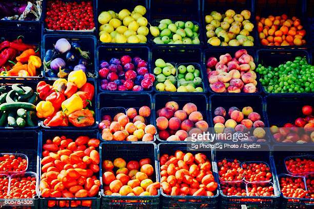 High Angle View Of Various Fruits And Vegetables In Crates For Sale At Street Market