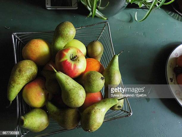 High Angle View Of Various Fruits In Container On Table