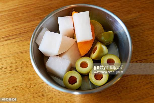 high angle view of various fruits in container on table - green olive fruit stock pictures, royalty-free photos & images