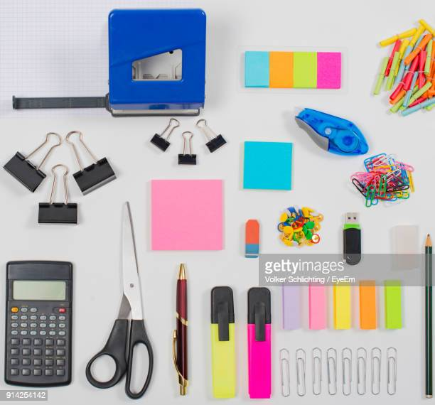 high angle view of various objects against white background - office supply stock photos and pictures
