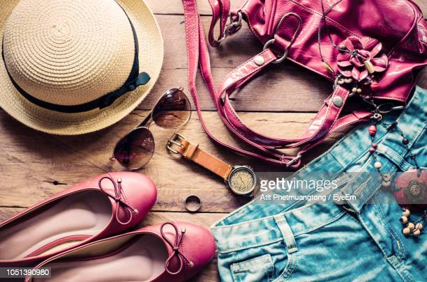 high angle view of various objects on table - pink pants stock pictures, royalty-free photos & images