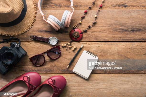 high angle view of various objects on table - womenswear stock pictures, royalty-free photos & images