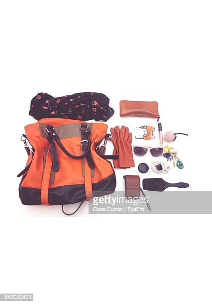 High Angle View Of Various Personal Accessories Against White Background