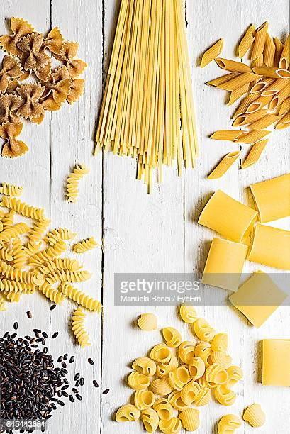 High Angle View Of Various Raw Pastas On Table