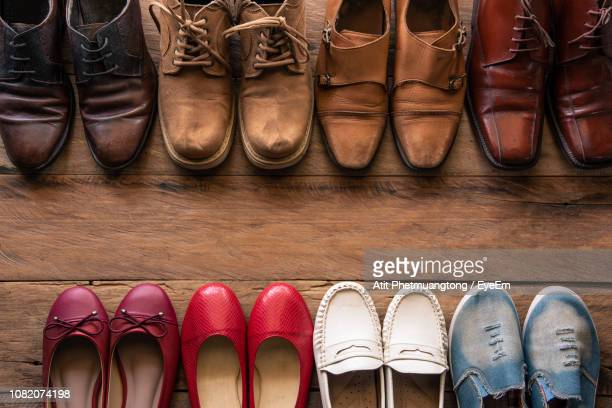 high angle view of various shoes on wooden table - eyeem collection stock pictures, royalty-free photos & images
