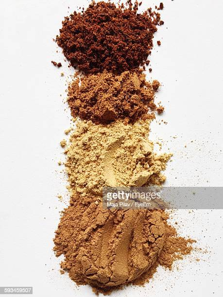 High Angle View Of Various Spice Powder On Table