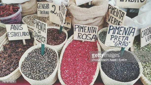 high angle view of various spices and grains for sale in market - cascais stock photos and pictures