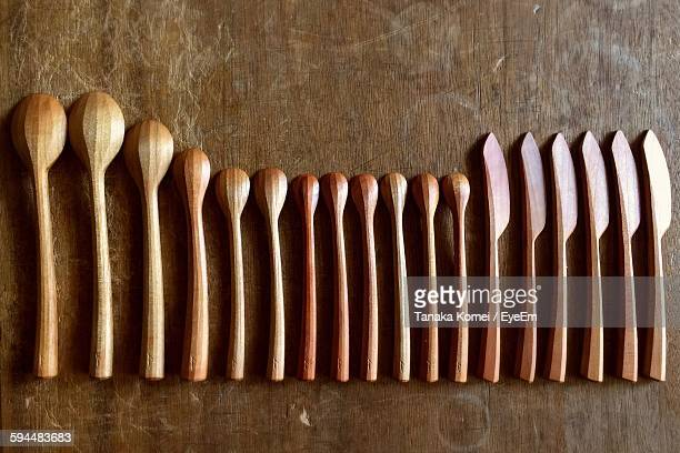 High Angle View Of Various Spoons Arranged On Table