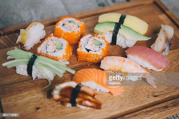 High angle view of various sushi on cutting board