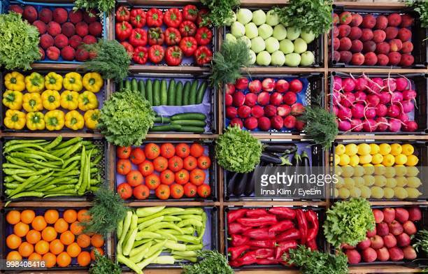 high angle view of various vegetables and fruits for sale at market stall - markt stockfoto's en -beelden