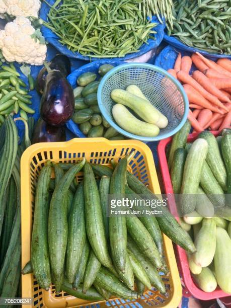 high angle view of various vegetables for sale at market - loofah stock photos and pictures