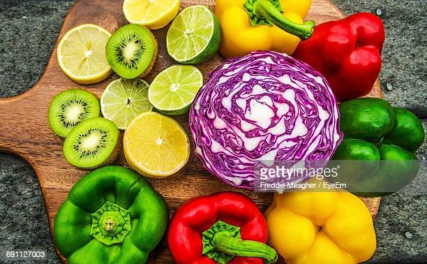 High Angle View Of Vegetables And Fruits On Cutting Board