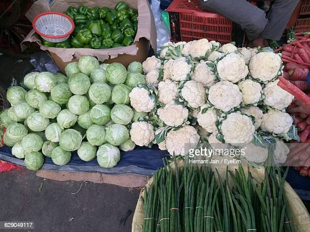 high angle view of vegetables for sale at market - moringa oleifera stock photos and pictures