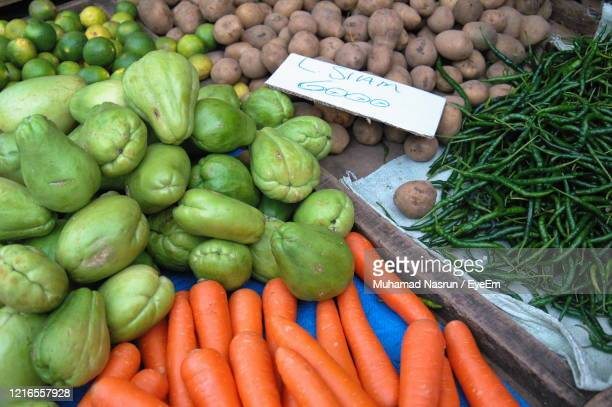 high angle view of vegetables for sale in market - muhamad nasrun stock pictures, royalty-free photos & images