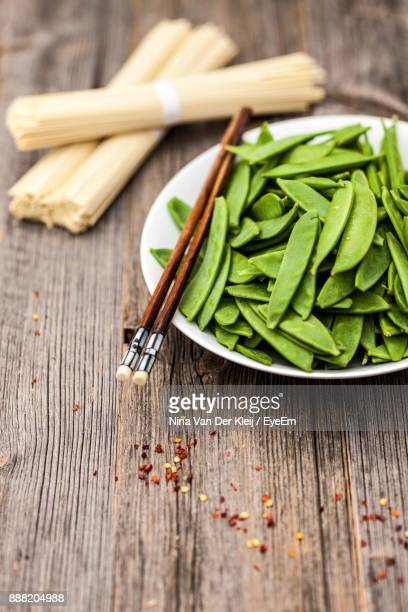 High Angle View Of Vegetables In Bowl On Wooden Table