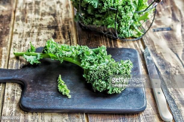 high angle view of vegetables on table - kale stock pictures, royalty-free photos & images