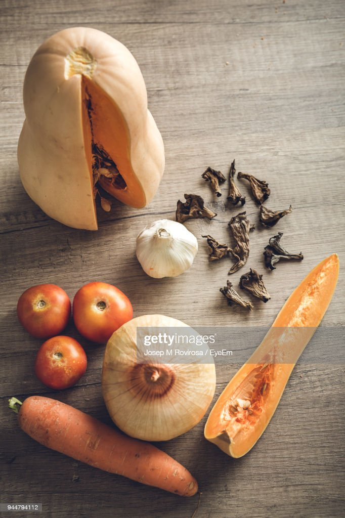 High Angle View Of Vegetables With Spice On Table : Stock Photo