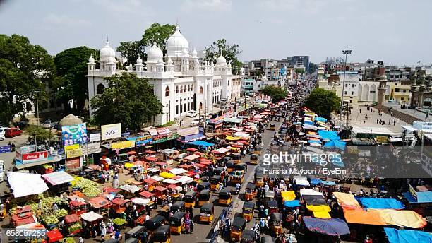 High Angle View Of Vehicles Amidst Buildings On Sunny Day In City