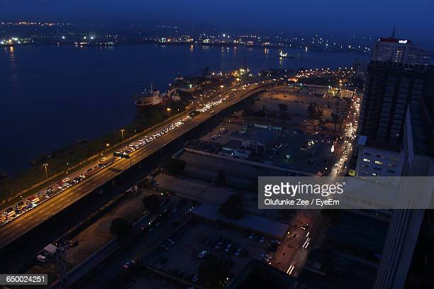 high angle view of vehicles on road against the sea - lagos nigeria stock pictures, royalty-free photos & images