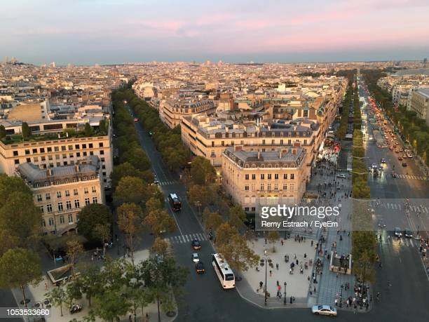 high angle view of vehicles on road amidst buildings in city - champs elysees quarter stock pictures, royalty-free photos & images