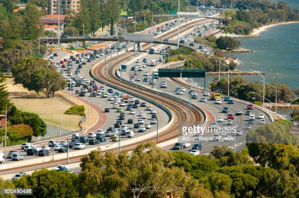 high angle view of vehicles on road amidst trees in city - perth australia stock pictures, royalty-free photos & images