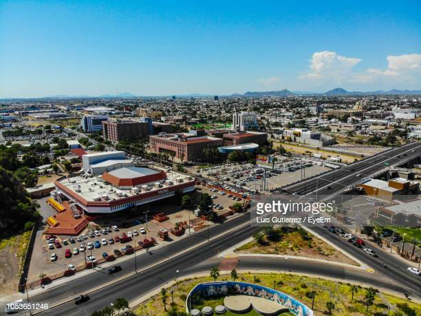 high angle view of vehicles on road by buildings against sky - hermosillo fotografías e imágenes de stock