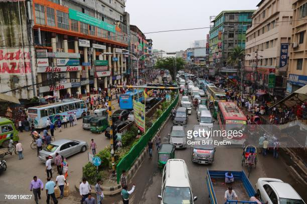 high angle view of vehicles on street in city - bangladesh stock pictures, royalty-free photos & images