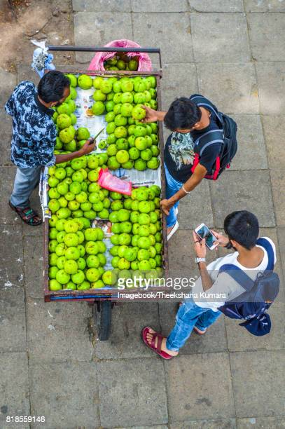 high angle view of vendor selling fruits - imagebook stock pictures, royalty-free photos & images
