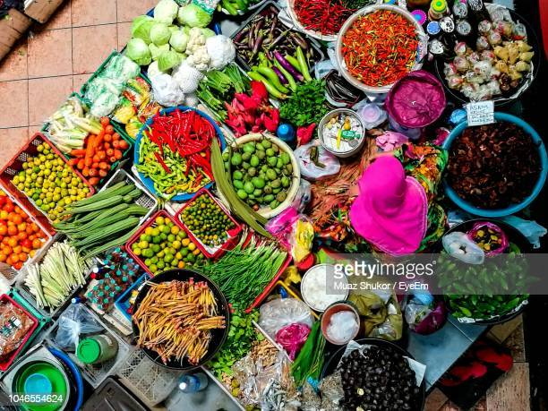 high angle view of vendor selling vegetables at market - malaysia stock pictures, royalty-free photos & images