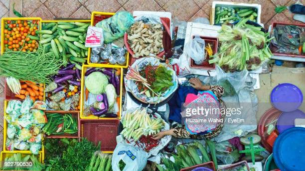 High Angle View Of Vendor Selling Vegetables At Market