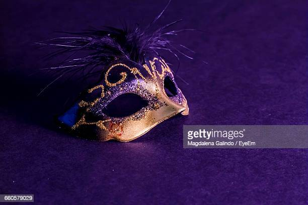 High Angle View Of Venetian Mask On Purple Background