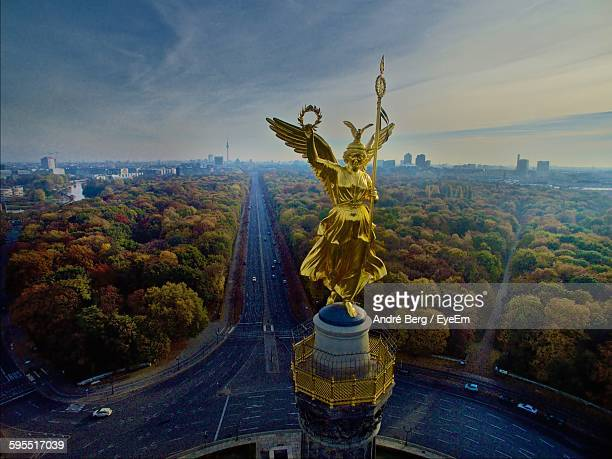 high angle view of victory column against sky - berlin stock-fotos und bilder