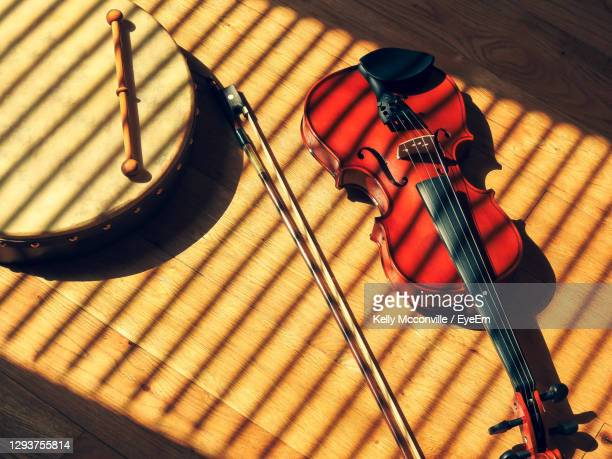 high angle view of violin and frame drum on table - ireland stock pictures, royalty-free photos & images