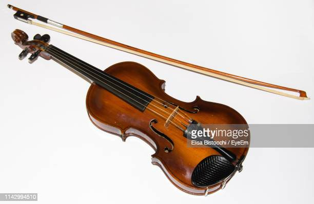 High Angle View Of Violin On White Background