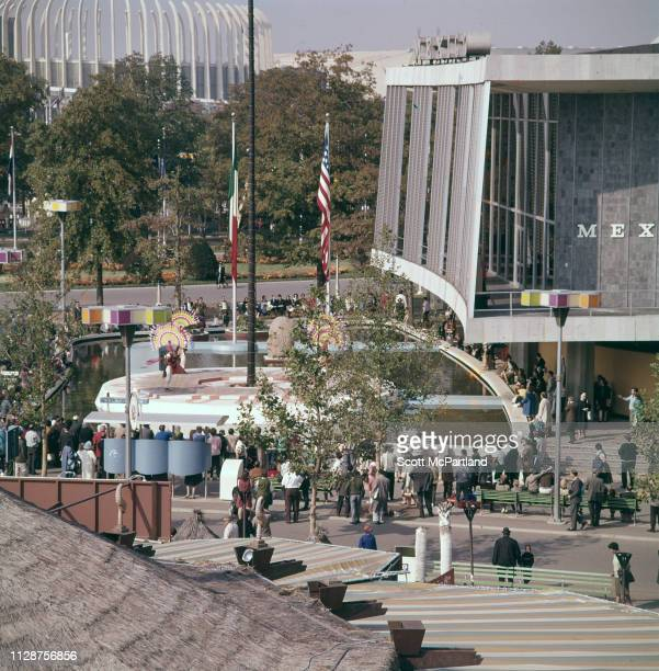 High angle view of visitors as they watch a performance outside the Mexico Pavilion in Flushing Meadows Park during the World's Fair in Queens New...