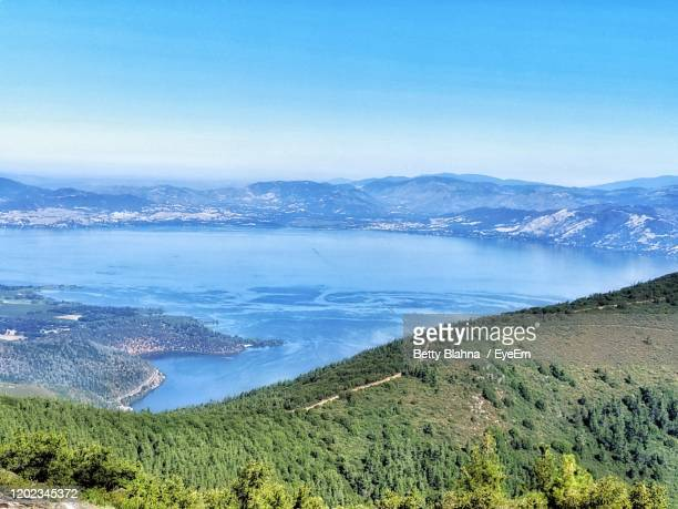high angle view of volcanic lake against sky from rim - 斜めから見た図 ストックフォトと画像