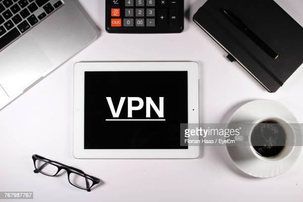 High Angle View Of Vpn Text On Digital Tablet With Objects On Table