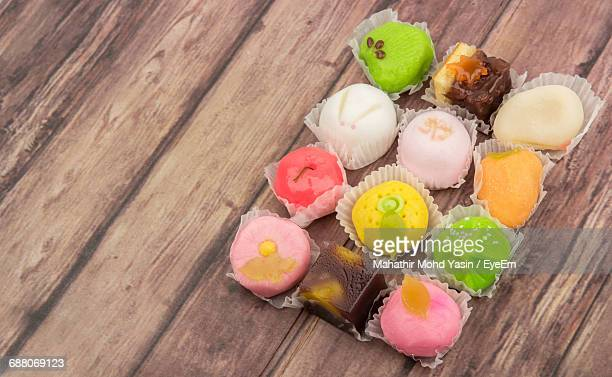 high angle view of wagashi on wooden table - wagashi stock pictures, royalty-free photos & images