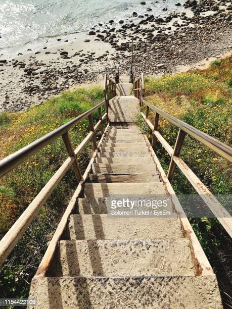 high angle view of walkway amidst sea - solomon turkel stock pictures, royalty-free photos & images