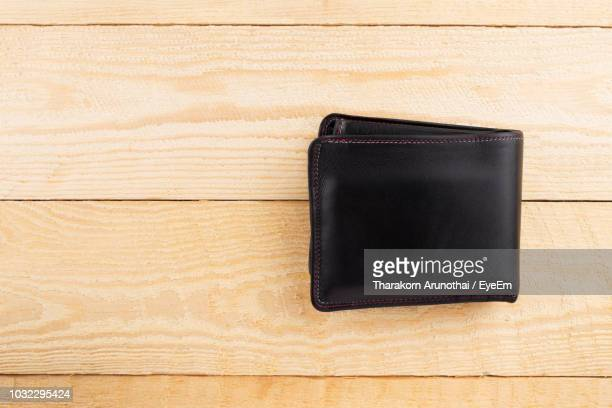 high angle view of wallet on table - wallet stock pictures, royalty-free photos & images