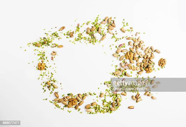 High Angle View Of Walnuts And Pistachios On White Background