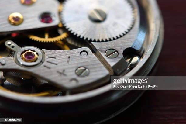 high angle view of watch on table - watch timepiece stock pictures, royalty-free photos & images