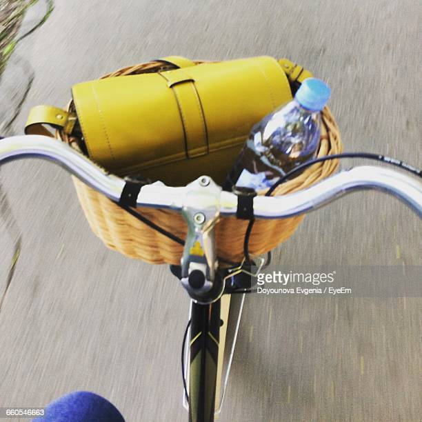 High Angle View Of Water Bottle And Purse In Bicycle Basket