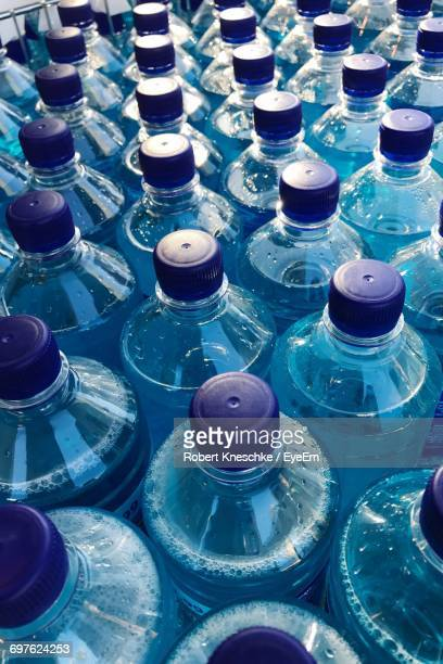 High Angle View Of Water Bottles