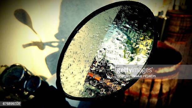 High Angle View Of Water Drops On Rear View Mirror Of Motorcycle