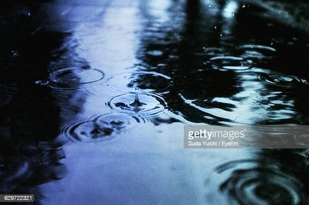 High Angle View Of Water Drops Splashing On Puddle During Monsoon