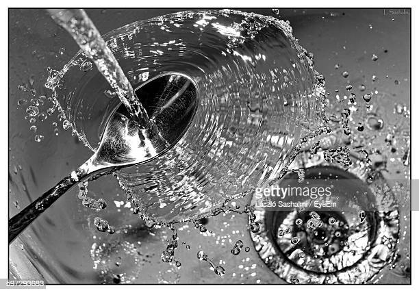 High Angle View Of Water Falling On Spoon In Kitchen Sink
